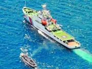 菲渔船在南沙五方礁搁浅被中国拖走